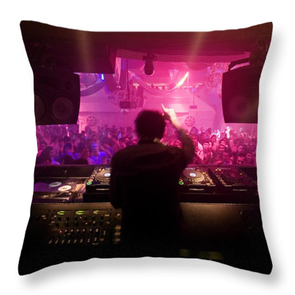 A Dj Plays To His Crowds On A Busy Throw Pillow by Justin Guariglia