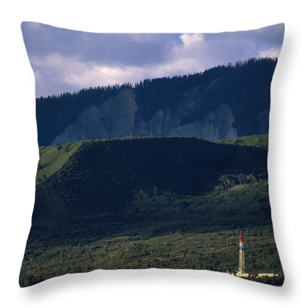 A Gas Drilling Rig At The Foot Throw Pillow by Joel Sartore