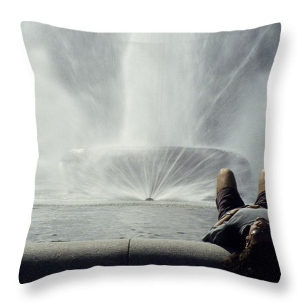 A Man Relaxes At A Fountain Throw Pillow by Stacy Gold