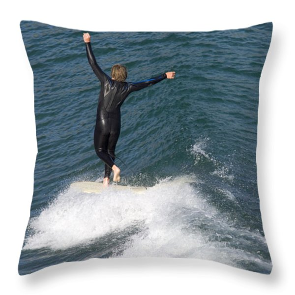 A Man Surfs A Longboard At Refugio Throw Pillow by Rich Reid