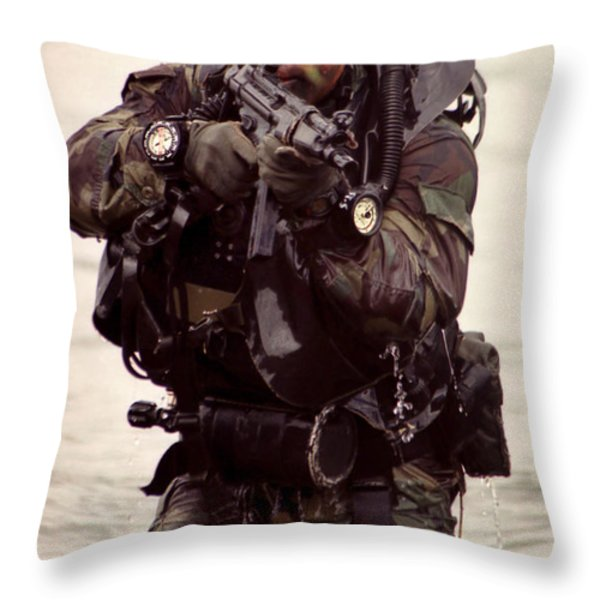 A Navy Seal Exits The Water Armed Throw Pillow by Michael Wood