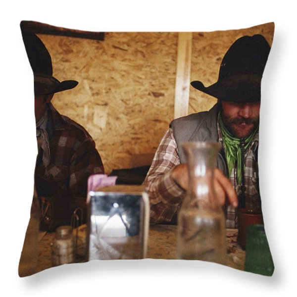 A Pair Of Cowboys Enjoy A Cup Of Coffee Throw Pillow by Joel Sartore