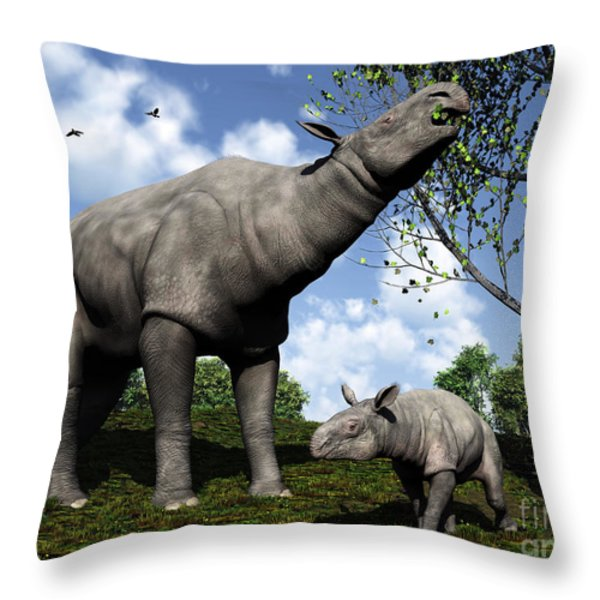 A Paraceratherium Mother Grazes Throw Pillow by Walter Myers