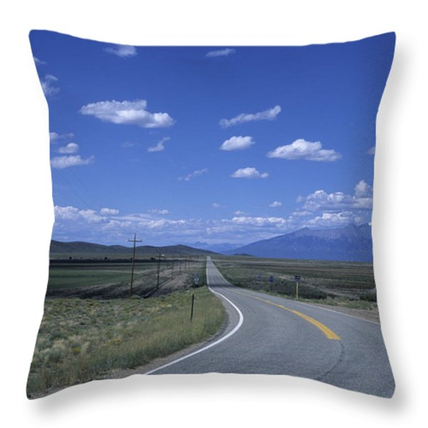 A Road Disappears Into The Distance Throw Pillow by Taylor S. Kennedy