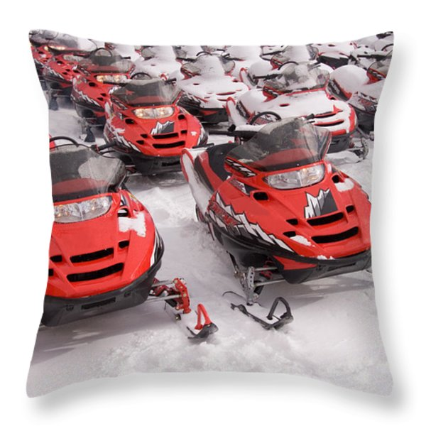 A Row Of Snowmobiles Sit Waiting Throw Pillow by Taylor S. Kennedy