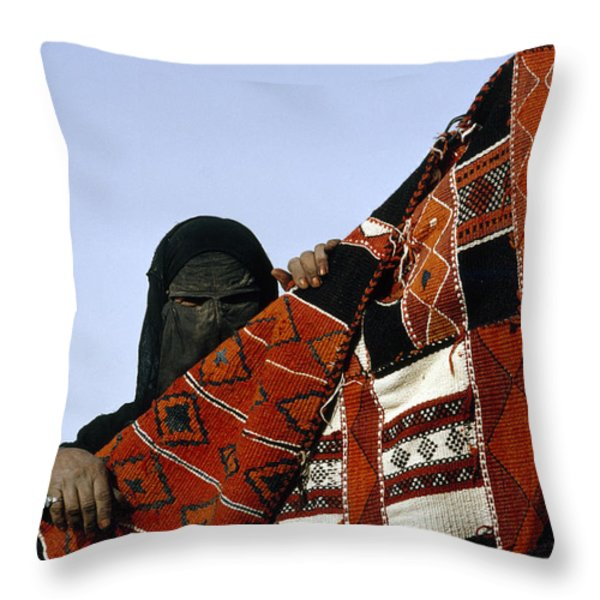 A Veiled Bedouin Woman Peers Throw Pillow by Thomas J. Abercrombie