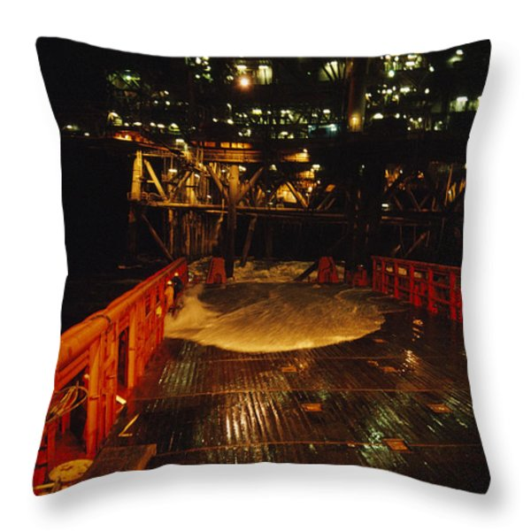A Wave Knocks Down Industrial Workers Throw Pillow by David Doubilet