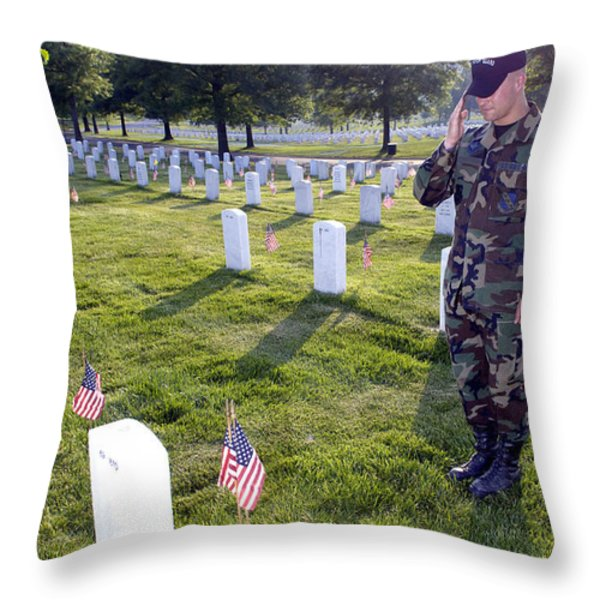An Airman Renders Honors After Placing Throw Pillow by Stocktrek Images