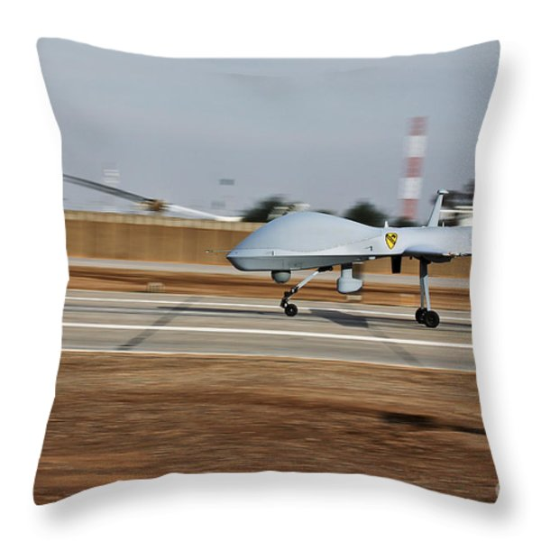 An Mq-1c Sky Warrior Uav Lands At Camp Throw Pillow by Stocktrek Images