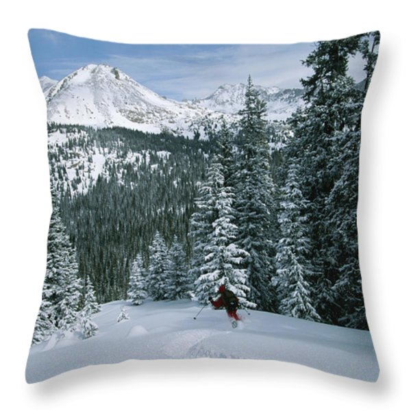 Backcountry Skiing Into An Evergreen Throw Pillow by Tim Laman