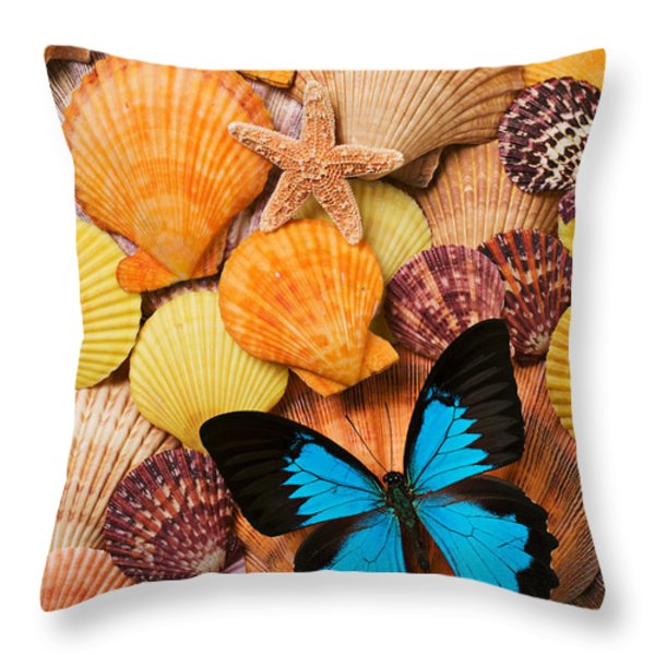 Blue butterfly and sea shells Throw Pillow by Garry Gay
