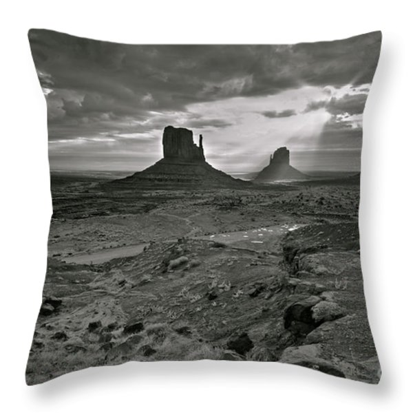 Breaking Light at Monument Valley - Black and White Throw Pillow by Brian Stamm