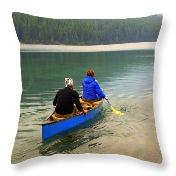 Canoeing Glacier Park Throw Pillow by Marty Koch