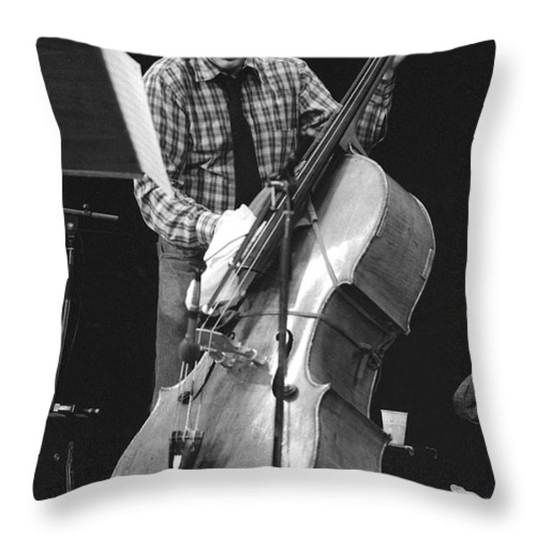 Charlie Haden Takes Care Of His Doublebass Throw Pillow by Philippe Taka