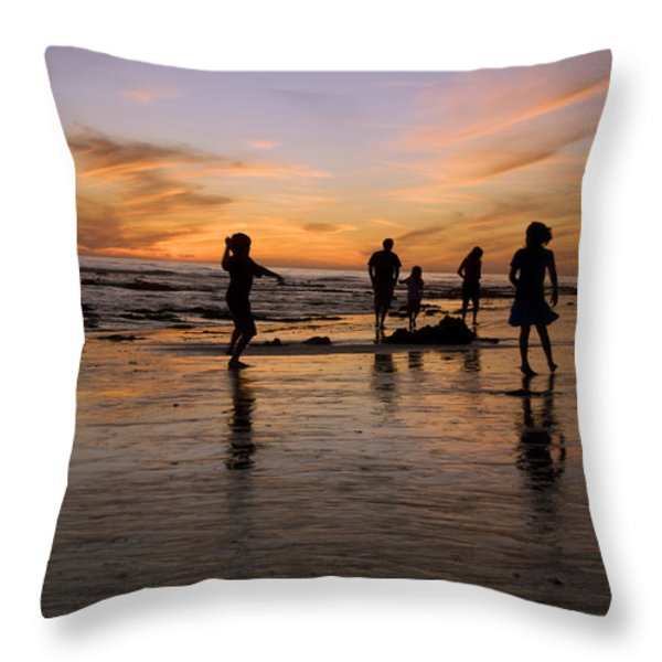 Children Playing On The Beach At Sunset Throw Pillow by James Forte