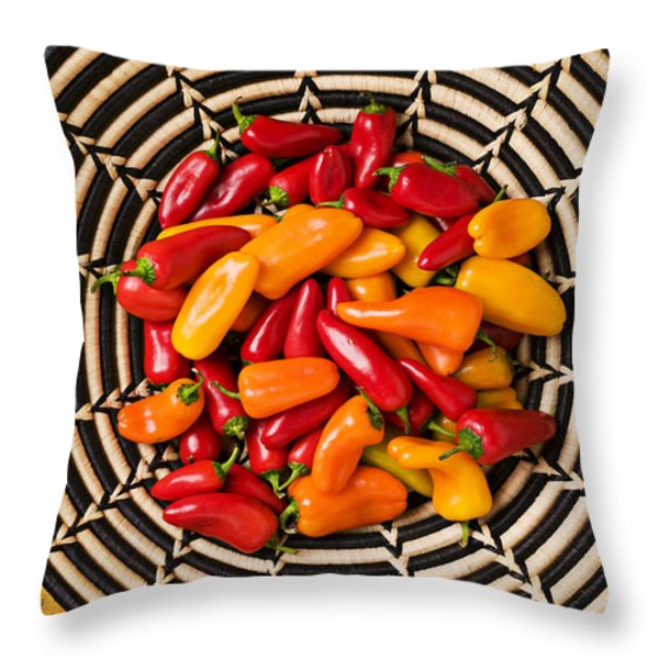 Chili peppers in basket  Throw Pillow by Garry Gay