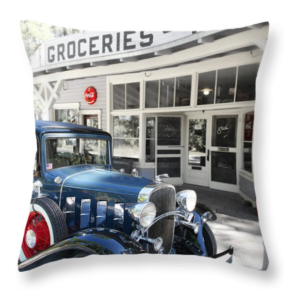 Classic Chevrolet Automobile Parked Outside The Store Throw Pillow by Mal Bray