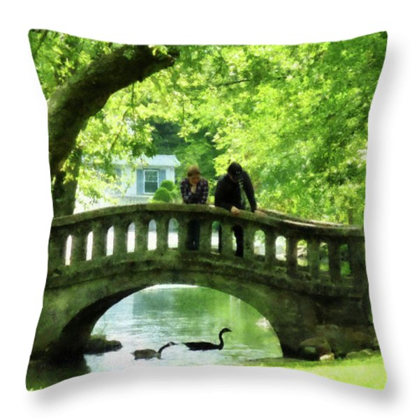 Couple On Bridge In Park Throw Pillow by Susan Savad