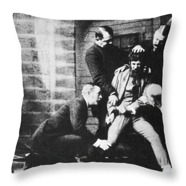 Criminal Being Held Down For Mug Shot Throw Pillow by Photo Researchers