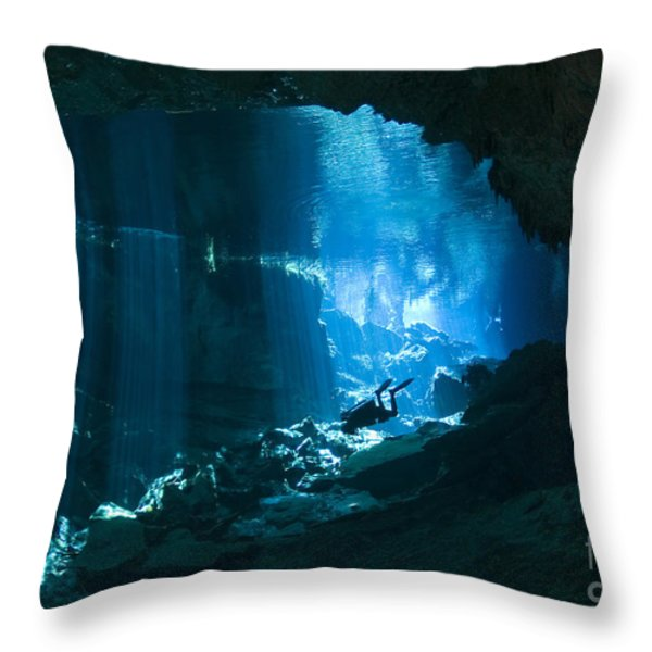 Diver Enters The Cavern System N Throw Pillow by Karen Doody