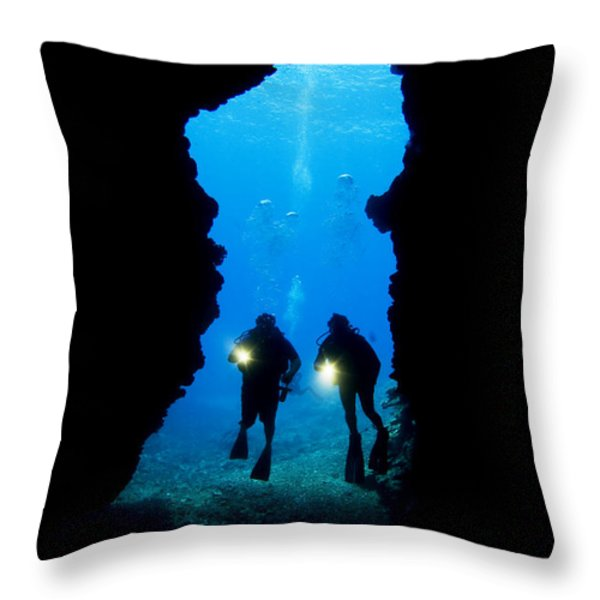 Divers Silhouetted Through Reef Throw Pillow by Dave Fleetham - Printscapes