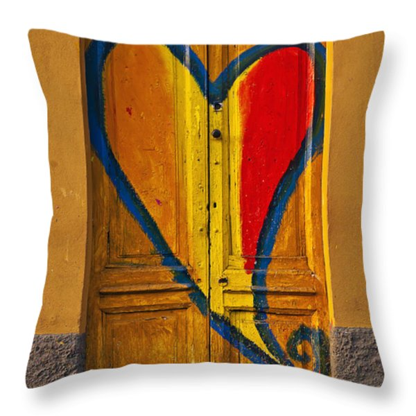 door with heart Throw Pillow by Joana Kruse