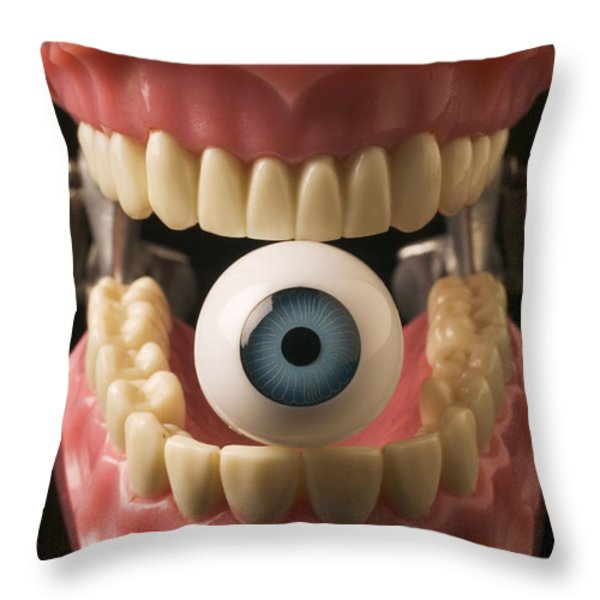 Eye held by teeth Throw Pillow by Garry Gay