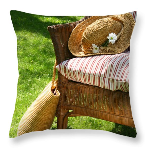 Grass lawn with a wicker chair  Throw Pillow by Sandra Cunningham
