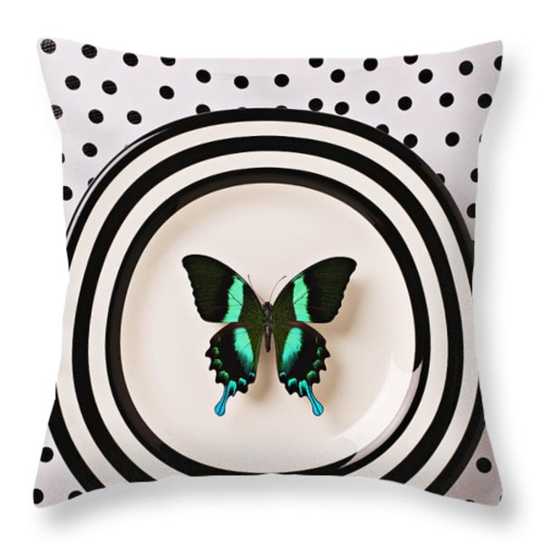 Green and black butterfly on plate Throw Pillow by Garry Gay