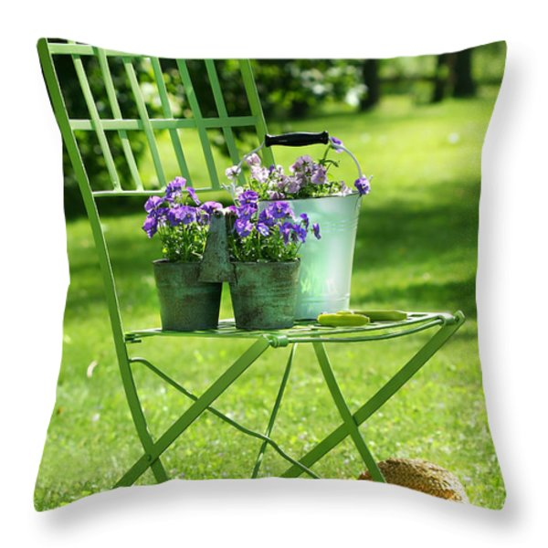 Green garden chair Throw Pillow by Sandra Cunningham