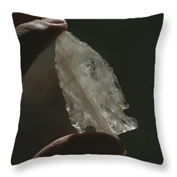 Hand Holding An Indian Arrowhead Throw Pillow by Todd Gipstein