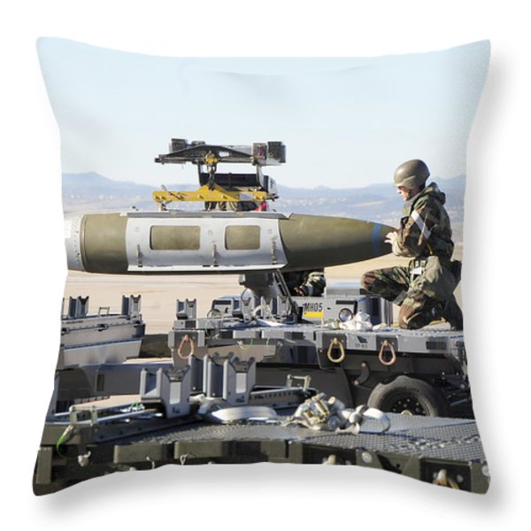 Irman Assists In Lowering A Guided Bomb Throw Pillow by Stocktrek Images