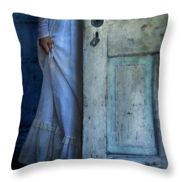 Lady in Vintage Clothing Hiding Behind Old Door Throw Pillow by Jill Battaglia