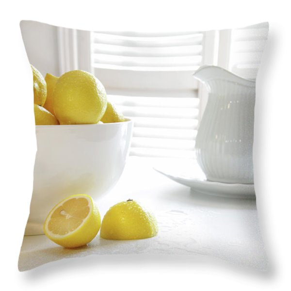 Lemons in large bowl on table Throw Pillow by Sandra Cunningham