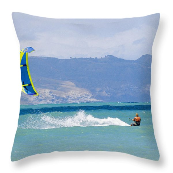 Man Kiteboarding In Turquoise Water Throw Pillow by Mark Cosslett