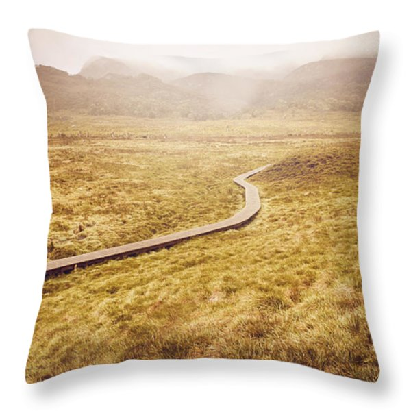 Man on expedition along Cradle Mountain Boardwalk Throw Pillow by Ryan Jorgensen