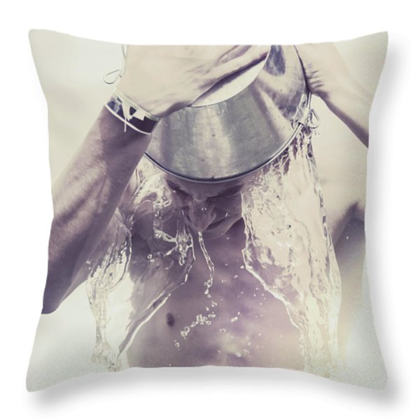 Man pouring cold water from wine cooler over body Throw Pillow by Ryan Jorgensen