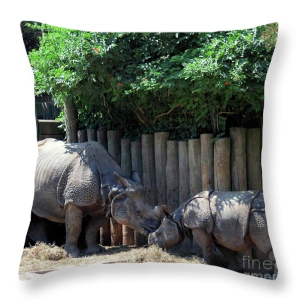 Mom Kissing Baby Throw Pillow by Kathleen Struckle