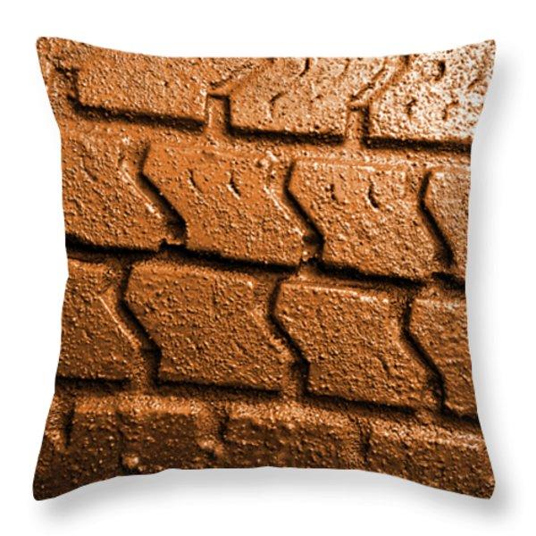 Muddy Tire Throw Pillow by Carlos Caetano