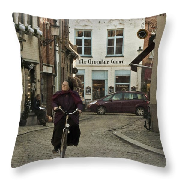 Nun On A Bicycle In Bruges Throw Pillow by Joan Carroll