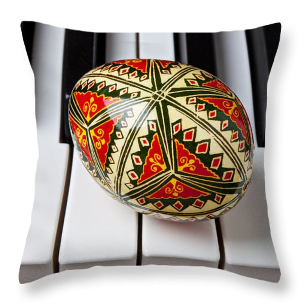 Painted Easter Egg On Piano Keys Throw Pillow by Garry Gay
