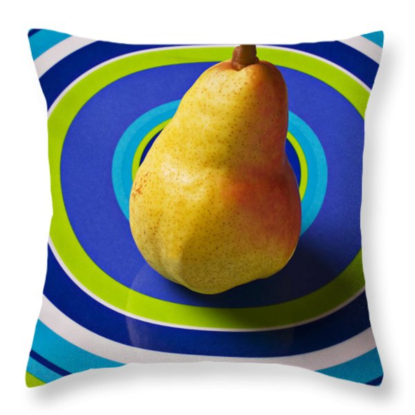 Pear on plate with circles Throw Pillow by Garry Gay