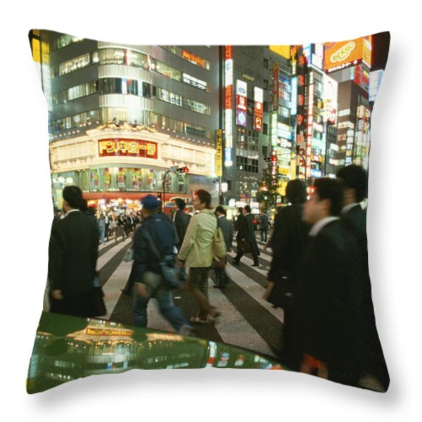 Pedestrians Cross A Crowded Tokyo Throw Pillow by Justin Guariglia