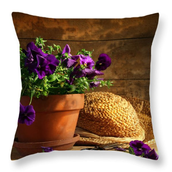 Pruning Purple Pansies Throw Pillow by Sandra Cunningham