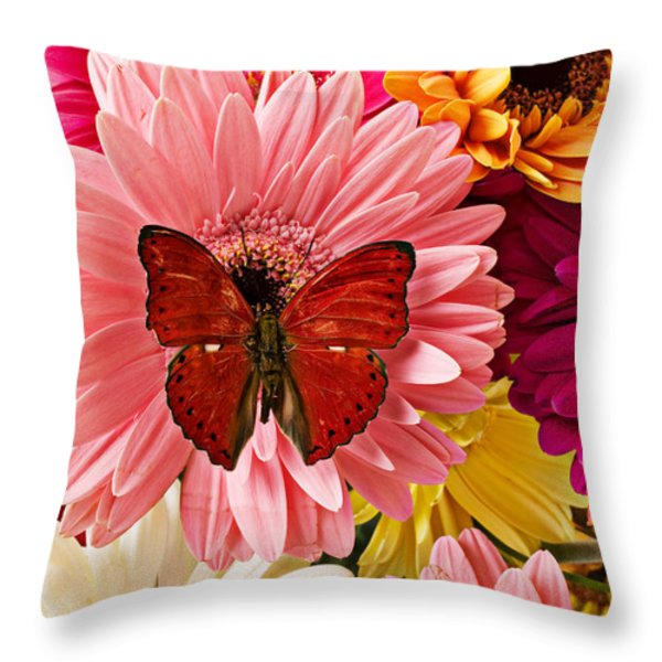 Red butterfly on bunch of flowers Throw Pillow by Garry Gay