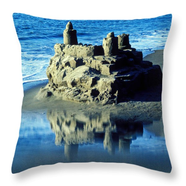 Sandcastle on beach Throw Pillow by Garry Gay