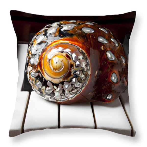 Snail Shell On Keys Throw Pillow by Garry Gay