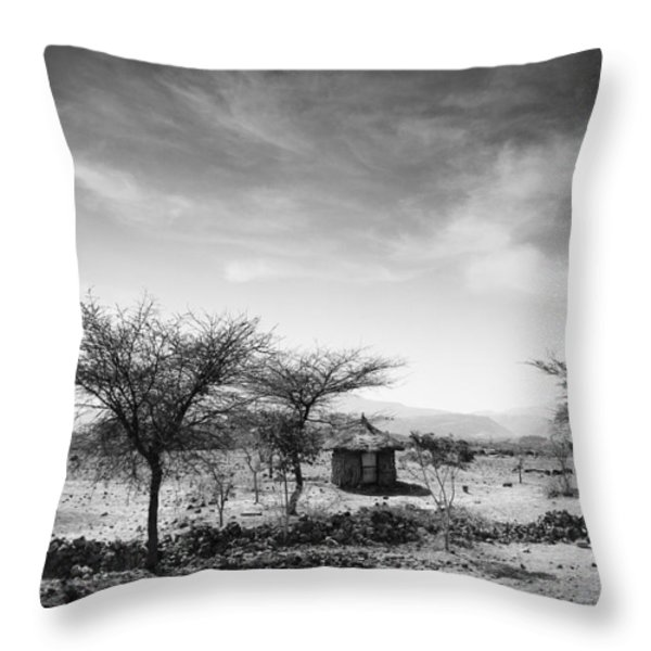 Stone Hut Set In Grassland Plains Throw Pillow by David DuChemin