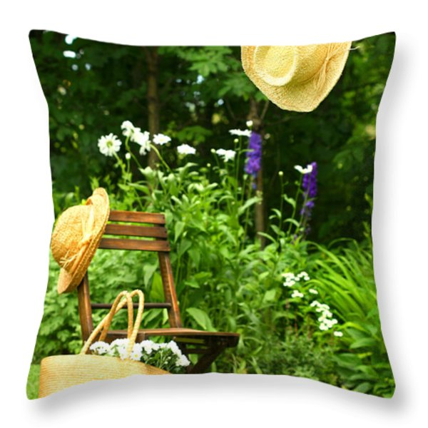 Straw Hat Hanging On Clothesline Throw Pillow by Sandra Cunningham