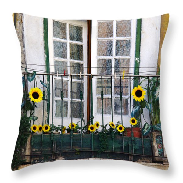 Sunflower balcony Throw Pillow by Carlos Caetano